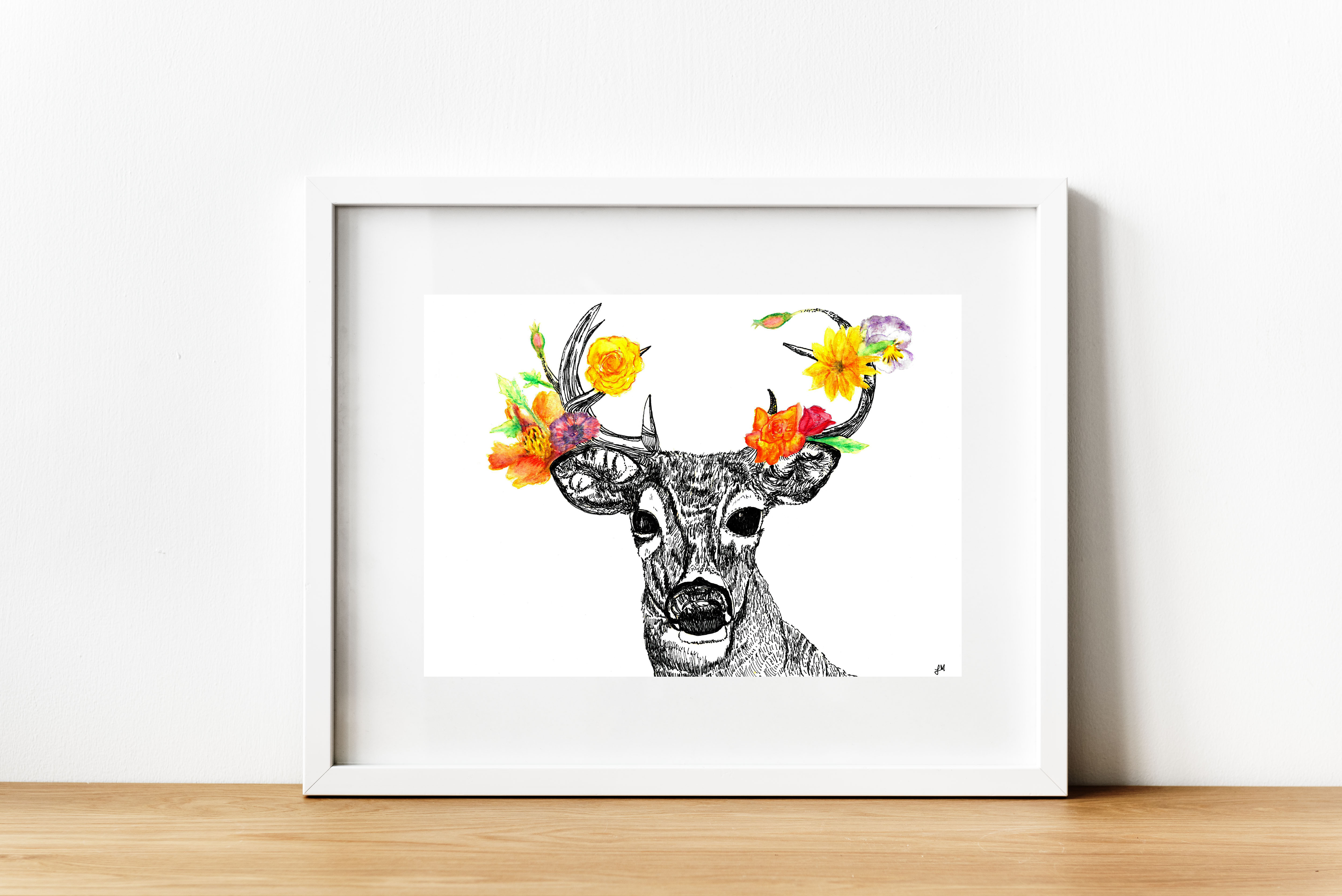A buck deer drawn in black pen sports antlers with bright yellow, orange and purple flowers.